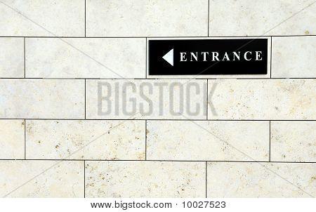 Black entrance sign