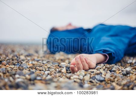 Unconscious Woman On Shingle Beach