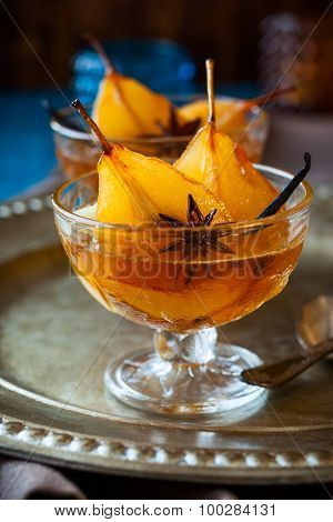 Poached pears in spiced syrup for holiday