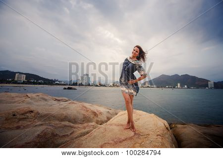 Young Long-legged Girl Barefoot Stands Tiptoe Against Sea