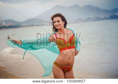 Slim Girl In Underwear Thrown Open Gown On Knees On Sand