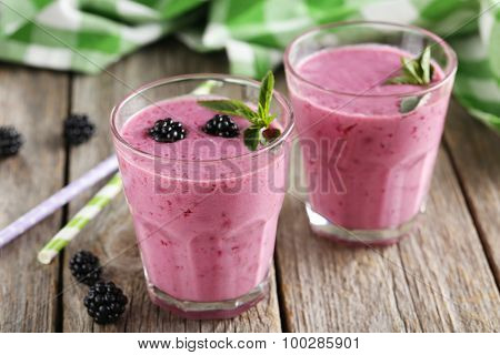 Blackberry Smoothie In The Glasses On Grey Wooden Background