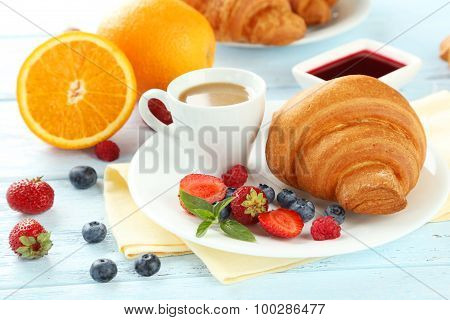 Fresh Tasty Croissants With Berries On Blue Wooden Background