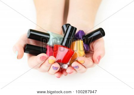Colorful Nail Polish Bottles In Woman Hands