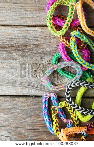 Colorful Rubber Band Bracelets On Grey Wooden Background