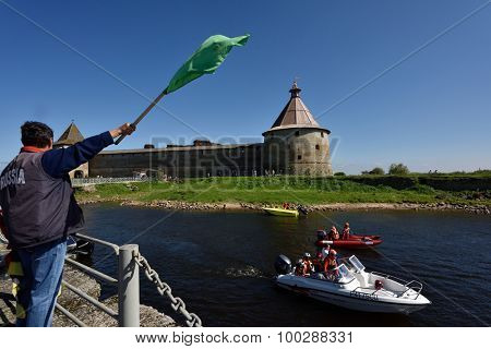 ORESHEK FORTRESS, LENINGRAD OBLAST, RUSSIA - AUGUST 15, 2015: Athletes prepare to second stage of the River marathon Oreshek Fortress race. This international motorboat competitions is held since 2003