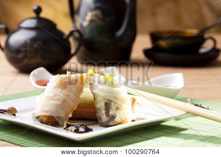 Portion Of Spring Rolls On Plate