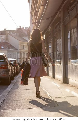Urban Girl Striding Through A City Street