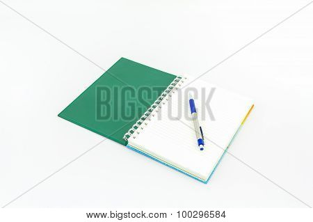 Open Green Book With Pen.