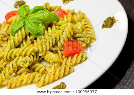 Close-up Of Dish Of Pasta With Pesto Genovese Sauce And Vegetables, Tomato And Basil