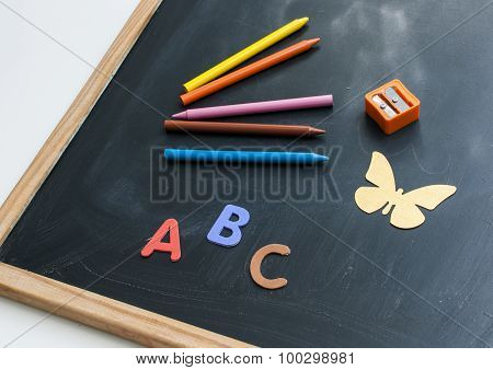 Blackboard with pencils of colors