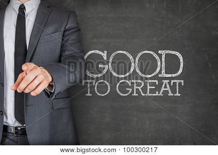 Good to great on blackboard with businessman