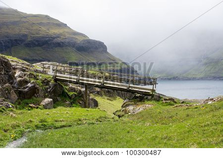 Landscape On The Faroe Islands With Bridge