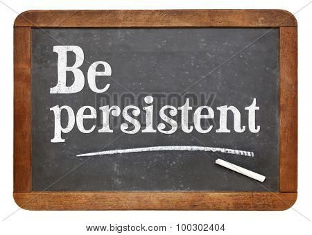 Be persistent - motivational advice on a vintage slate blackboard