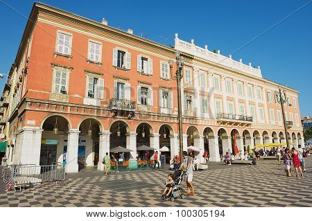 People walk by the Place Massena square in Nice, France.