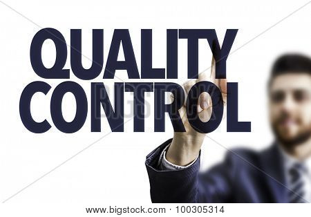 Business man pointing the text: Quality Control