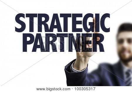 Business man pointing the text: Strategic Partner
