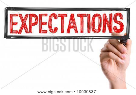 Hand with marker writing the word Expectations