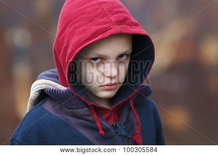 Dramatic Portrait Of A Homeless Boy
