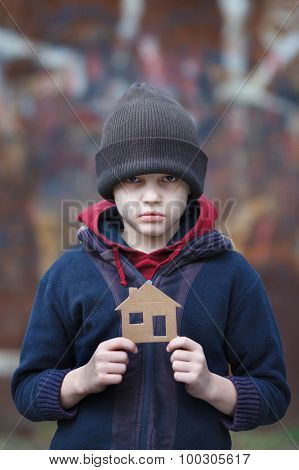 Homeless Boy Holding A Cardboard House