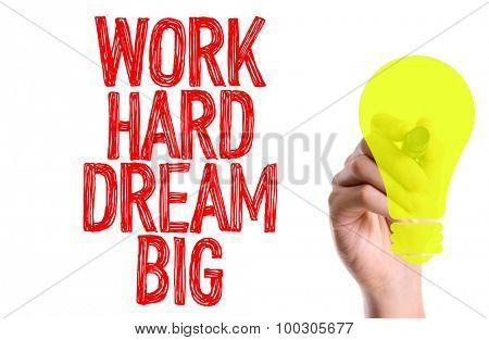 Hand with marker writing the word Work Hard Dream Big