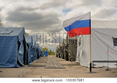 Training Refugees Camp Of Russian Emergency Control Ministry In Orel With Russian Flag And Cloudy Sk