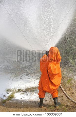 Russian Emergency Control Fireman In Orange Uniform Extinguishing Fire