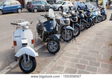 Classic Vespa And Honda Scooters Stands Parked
