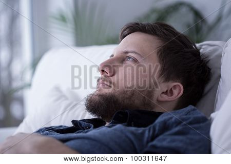 Tired Male Unable To Fall Asleep