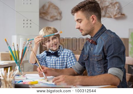 Talented Schoolboy With Teacher