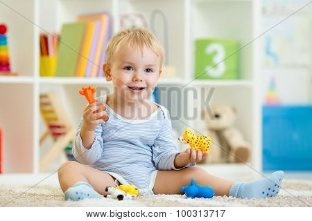 smart child playing animal toys