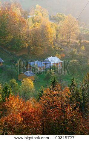 Autumn landscape with houses in a mountain village. Carpathians, Ukraine, Europe
