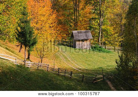 Autumn in the mountain village. Wooden shed
