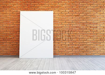 room with blank picture and brick wall