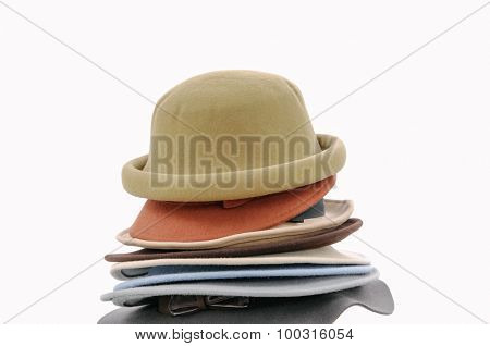 Stacked fedora hat isolated on white