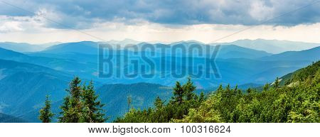Blue mountains covered with forest.