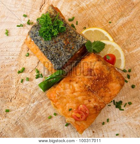 Salmon Steak With Lemon  On Wooden Background.