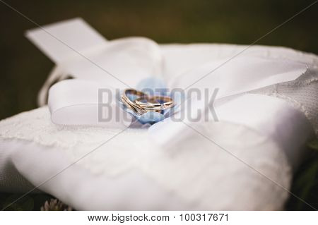 Gold Wedding Rings On A Pillow