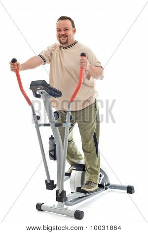 Man Exercising On Elliptical Trainer