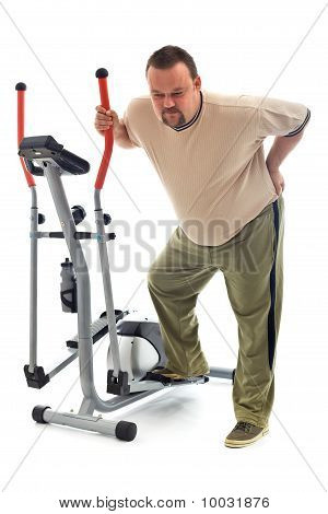 Man With Back Ache Near A Training Device