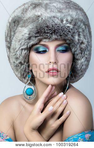 Beauty Portrait Of Young Pretty Lady Wearing Fur Cap