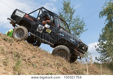 Black Off Road Car Is Sliding Down A Steep Slope