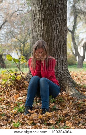 Young Woman  Crying In The Autumn Park