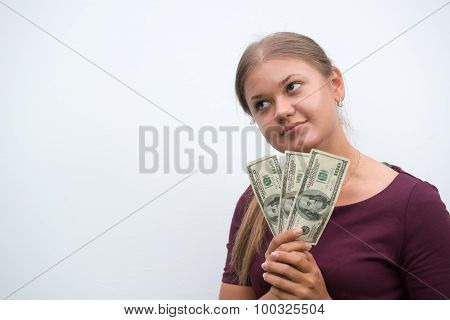 Young  Woman Holding Dollars In Hand