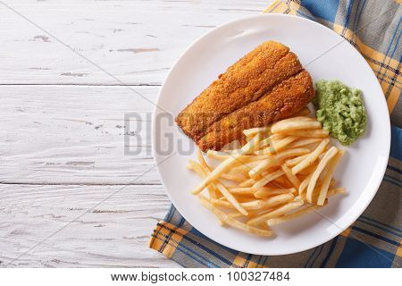 English Food: Fried Fish In Batter With Chips. Horizontal Top View