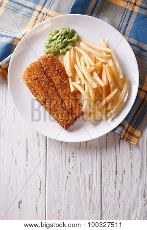English Food: Fried Fish In Batter With Chips. Vertical Top View