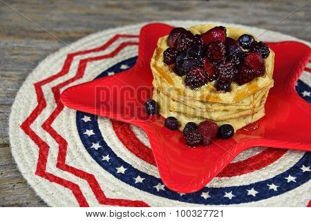 berries on waffles with syrup