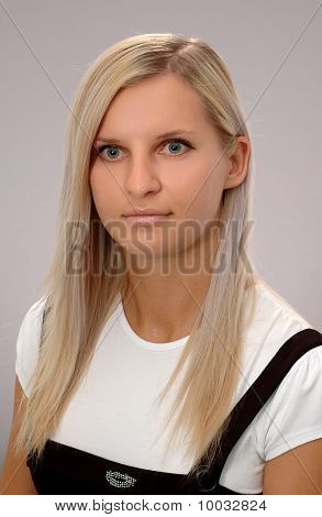 Young Businesswoman On Gray Background