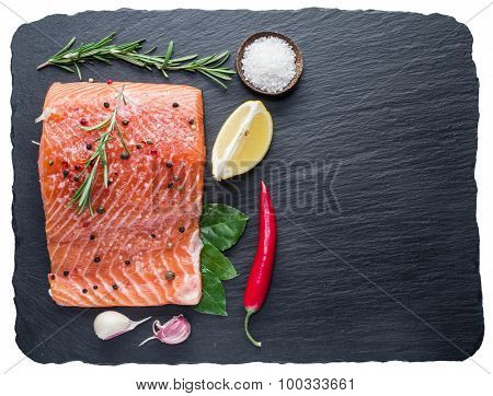 Fresh salmon on the black cutting board. File contains clipping paths.
