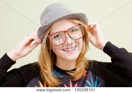 Young stylish girl in glasses sweatshirt with canabis pattern